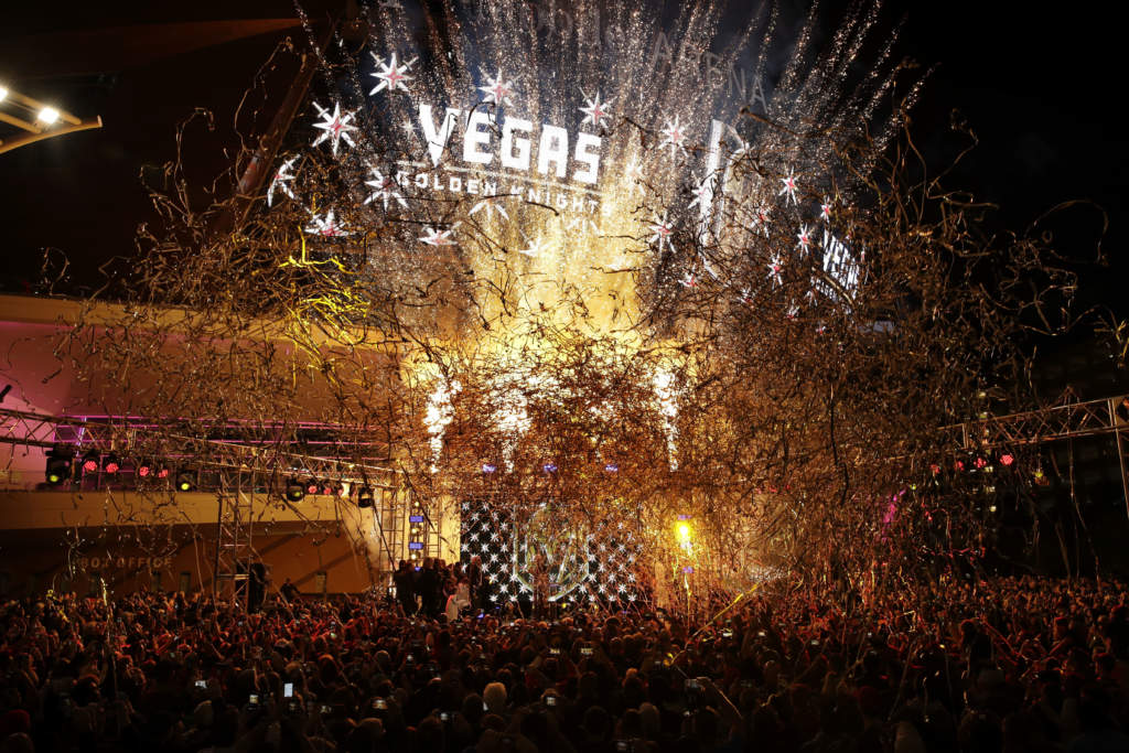 FILE - In this Nov. 22, 2016, file photo, confetti streams above the crowd during an event to unveil the name of Las Vegas' National Hockey League franchise in Las Vegas. The team will be called the Vegas Golden Knights. The U.S. Patent and Trademark Office denied the franchise's trademark application for the Golden Knights nickname on Dec. 7, 2016. (AP Photo/John Locher, File)