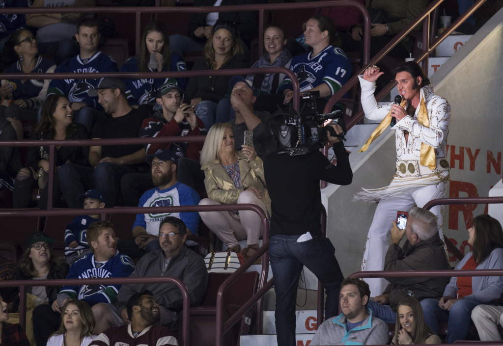 An Elvis Presley impersonator performs during a break in play as the Vancouver Canucks and the Vegas Golden Knights play during the second period of a preseason NHL hockey game in Vancouver, British Columbia, Sunday, Sept. 17, 2017. (Darryl Dyck/The Canadian Press via AP